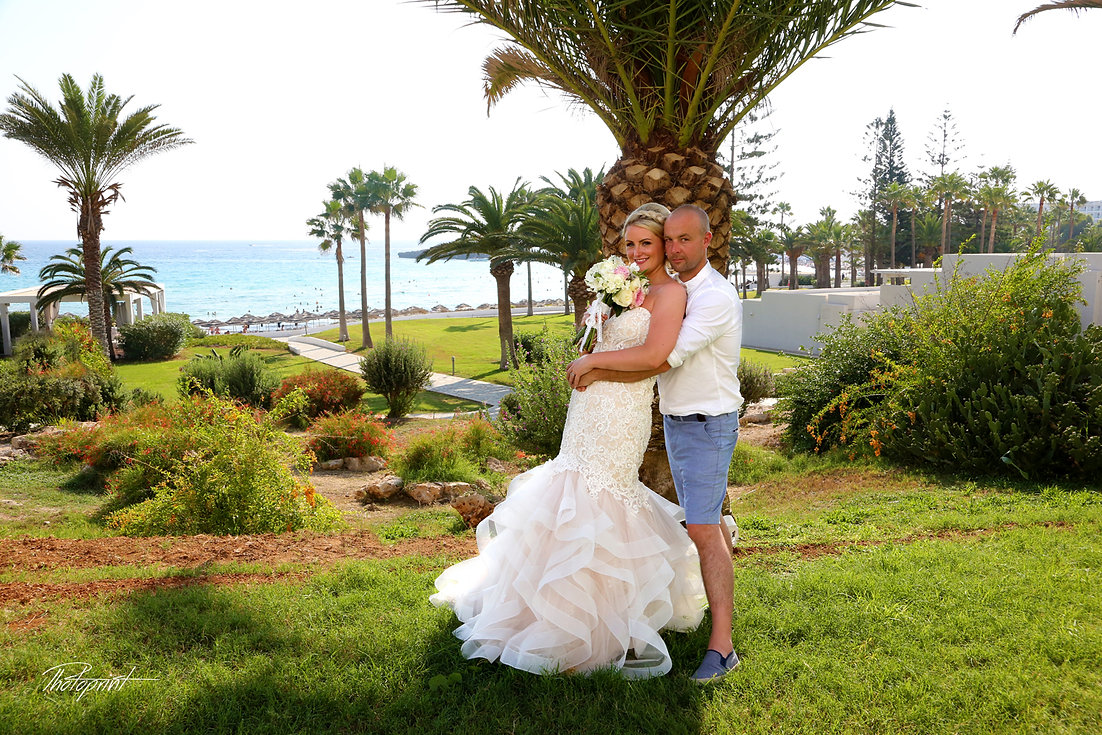 Beautiful wedding photo session outdoors ( Nissi beach resort in ayia napa ) of the elegant couple, bride in a white dress with veil holding a bouquet | bride, woman, wedding dress, wedding, nissi beach hotel, ayia napa