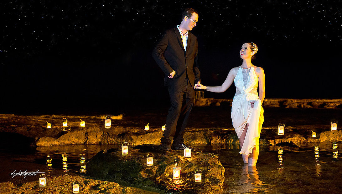 Romantic picture of the marriage couple holding hands by sea at night after the wedding ceremony | wedding photo ideas paphos cyprus, wedding paphos photographer