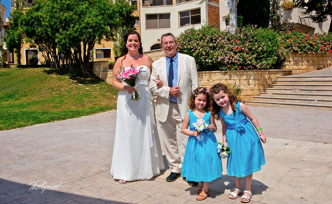 Gorgeous bride in wedding dress with bouquet of flowers coming with her father for the wedding ceremony  | wedding photography ideas paphos cyprus, cyprus wedding photographers paphos,phototographer in paphos