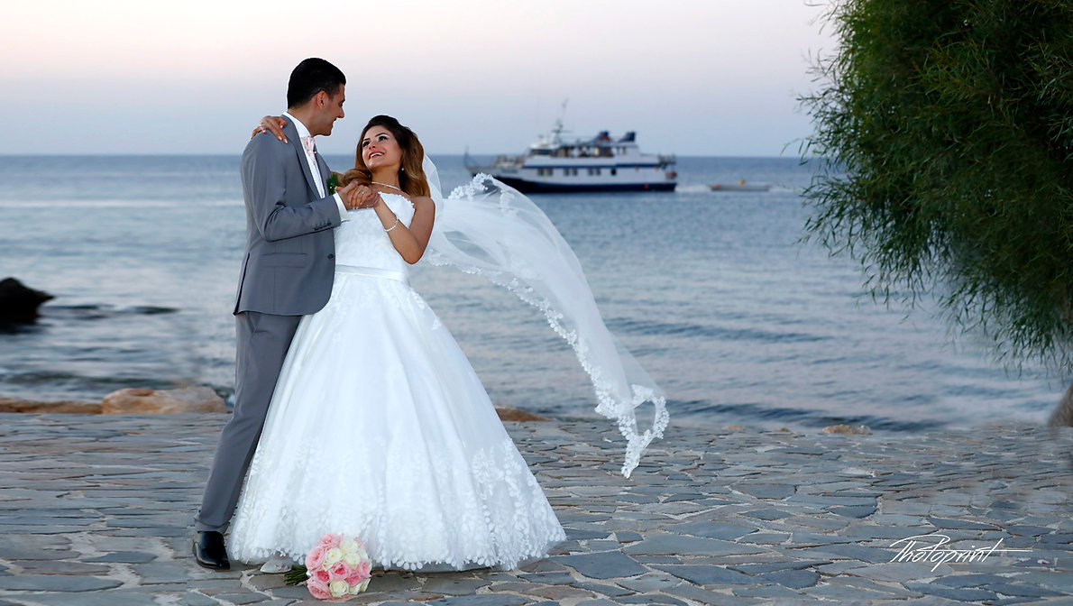 Wedding Couple Hugging Each Other outdoors at the seaside, the magnificent Mediterranean Sea in the background | wedding packages in protaras, professional wedding photographer protaras cyprus, wedding protaras photographers