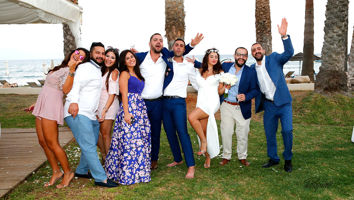 Happy Wedding guests with the newlyweds celebrating  |  Larnaca best wedding photography photographer, Larnaca wedding photography venues