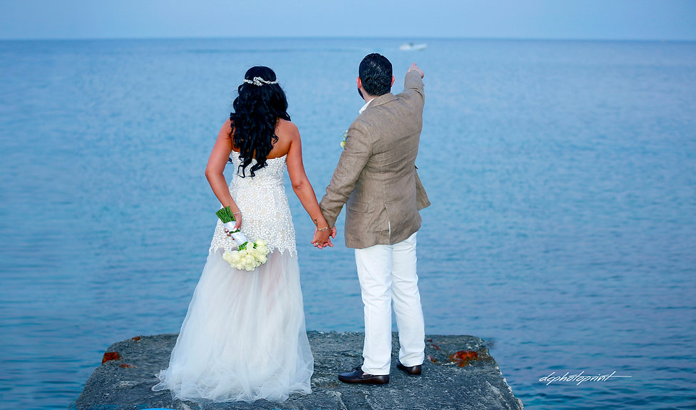 Happy just married young wedding couple celebrating and have fun at beautiful Protaras beach