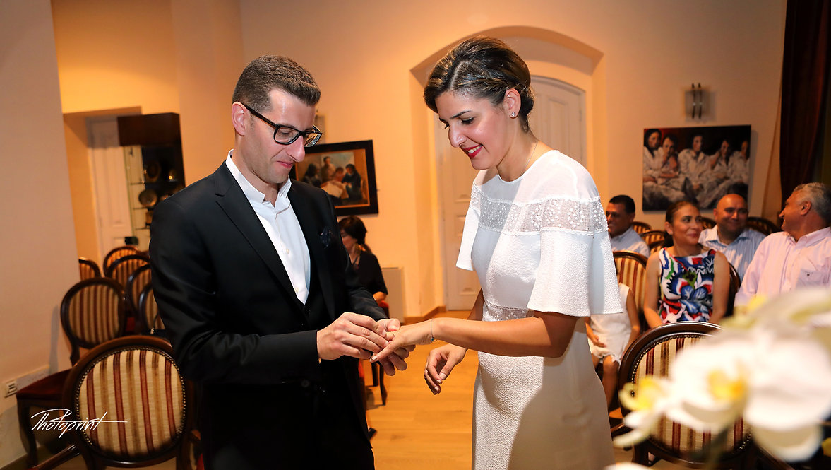 Rabih wears the wedding ring to Zeina during the wedding ceremony | cyprus wedding larnaca photography packages, cyprus wedding larnaca photography jobs