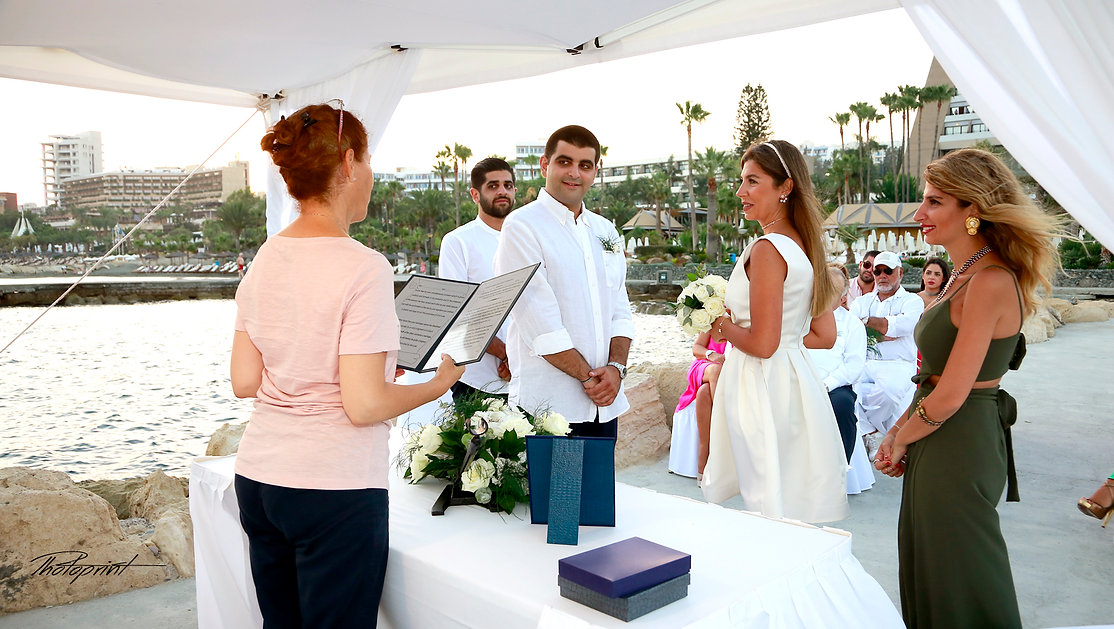 Beautiful and gentle wedding ceremony photo session outdoors in Amathus Beach Hotel in Limassol. | Bespoke wedding pictures ideas in Limassol cyprus
