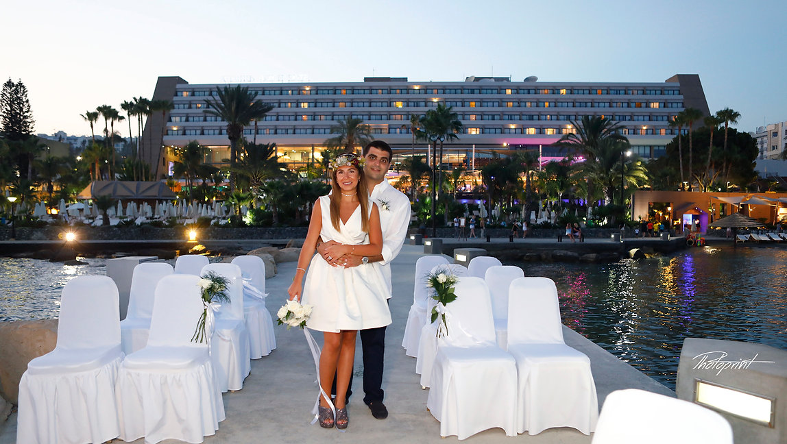Wedding couple enjoying romantic moments outdoors at the Amathus beach Hotel in Limassol | limassol best wedding photos cyprus, limassol best wedding photography photographer
