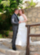Bride and groom kissing outdoors near Ottoman baths in Paphos | wedding photographers prices, best cyprus wedding photography websites