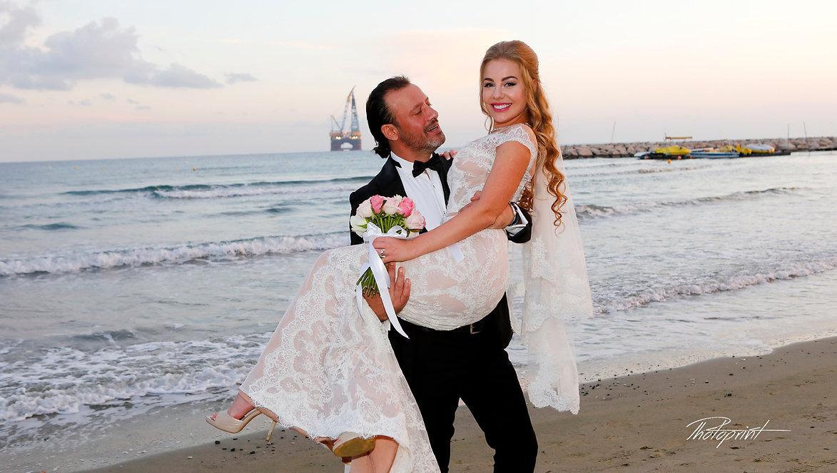 Beautiful and gentle wedding photo session outdoors of the elegant couple (bride in a white dress with veil holding a bouquet and groom in the classic tuxedo costume)  |  Larnaca photographer in town hall | larnaca cyprus wedding photographers prices