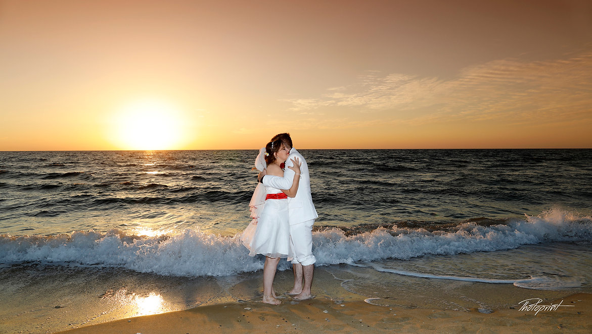 Bride and Groomin, Kissing at Sunset on a magnificent Mediterranean Sea in the background | cyprus wedding photographer paphos, wedding reception venues Paphos,cyprus wedding photographer prices