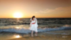Bride and Groomin, Kissing at Sunset on a magnificent Mediterranean Sea in the background   cyprus wedding photographer paphos, wedding reception venues Paphos,cyprus wedding photographer prices