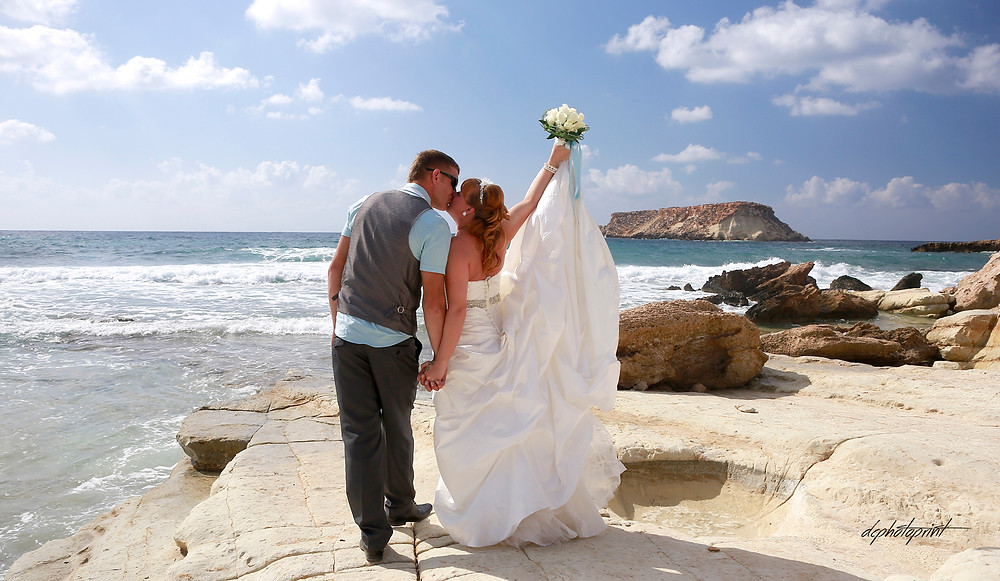 Beautiful and gentle wedding photo session outdoors of the elegant couple, bride in a white dress holding a bouquet.