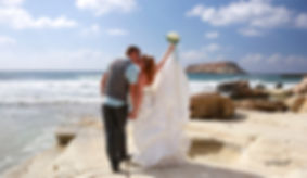 The bride and groom hugging on the shore of Paphos beach | paphos pics photography prices photographers cyprus, Paphos pics photography photographers cyprus