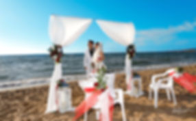Wedding arch decorated with flowers on Mediterranean sand beach. Bride holding beautiful wedding bouquet  Beautiful and gentle wedding photo session outdoors of the elegant couple. cyprus images wedding photography, cyprus photographer paphos, cyprus photographers, cyprus photography paphos