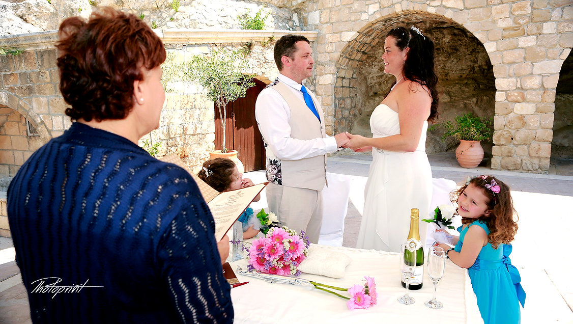 happy couple swearing love to each other during wedding ceremony | best cyprus wedding photographers paphos, cyprus wedding photographers paphos, wedding photography ideas paphos cyprus
