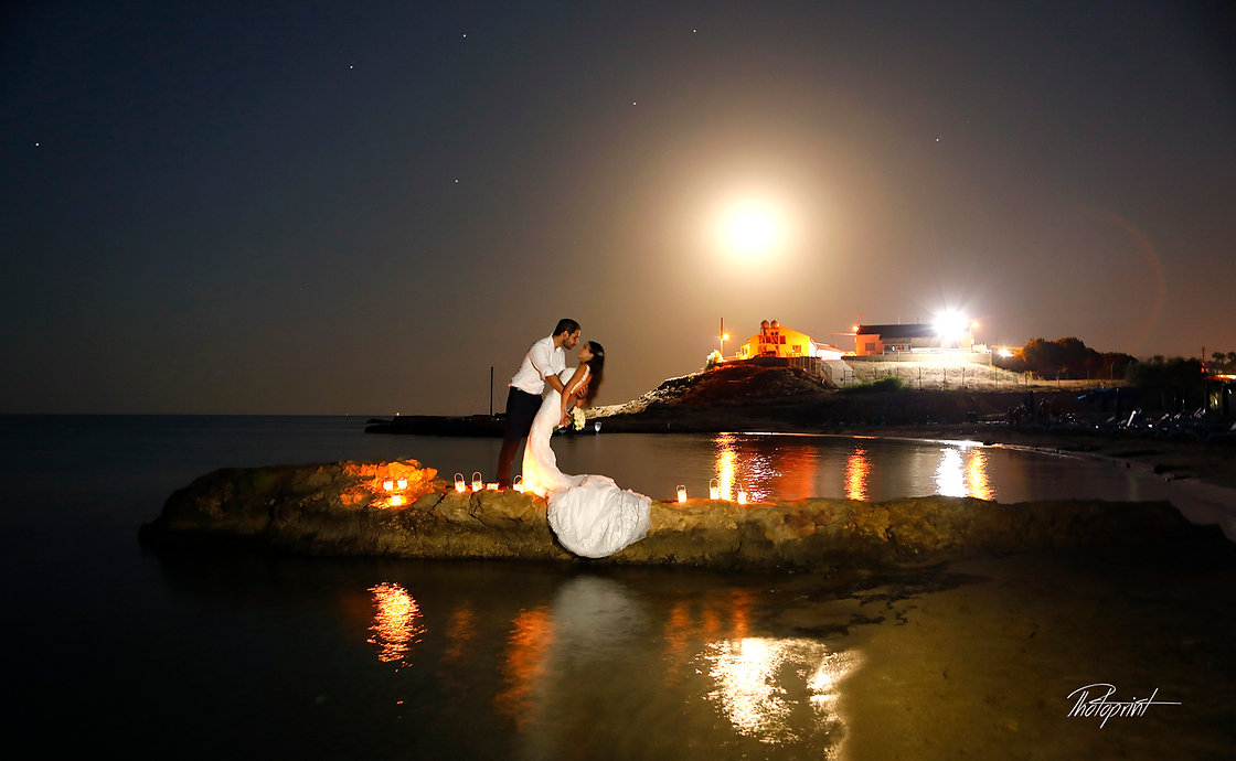 Super moon in starry sky on Protaras sea beach, bride and groom kissing passionately  |  Protaras civil weddings photographer, civil ceremomony at pprotaras town hall, beach weddings Protaras