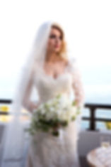 Gorgeous bride in wedding dress with bouquet of flowers posing in at AMATHUS BEACH HOTEL, Limassol  | best cyprus wedding venues photographers limassol, wedding venues photographer in limassol cyprus