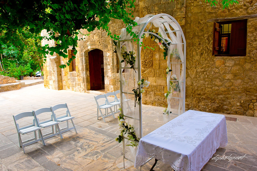 Wedding arch decorated with flowers outdoors, on Ottoman Baths in Paphos, cyprus | wedding paphos photographers photography, wedding photographers paphos
