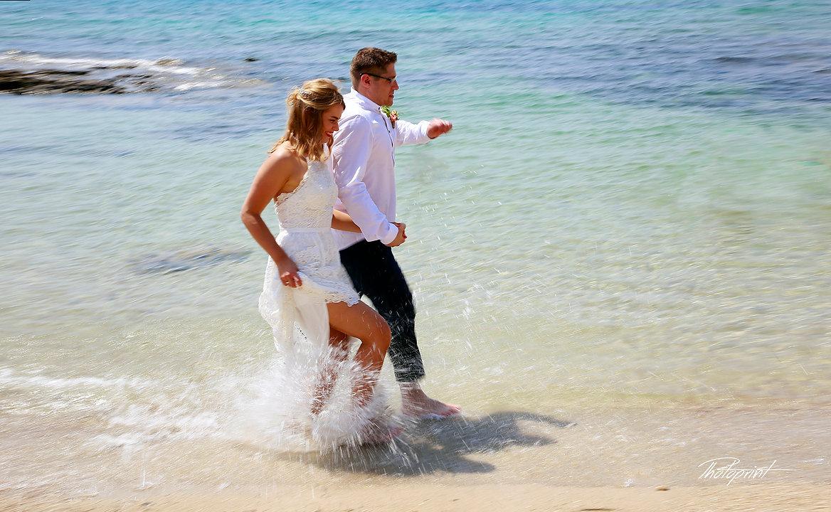 Couple running at ayia napa beach holding hands smiling |  town hall ayia napa cyprus, town hall ayia napa,cyprus wedding photographer ayia napa, cyprus wedding photographer ayia napa.