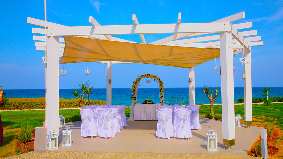 Wedding Kiosk decorated with flowers in Beautiful wedding set up, outdoor in the garden of Pernera Beach Hotel, in  Protaras, cyprus | protaras wedding photography venues, protaras  best wedding photography