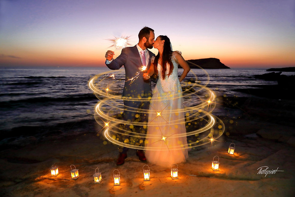 Beautiful young and attractive Couple kissing and celebrating holding sparkles by the beach at Paphos