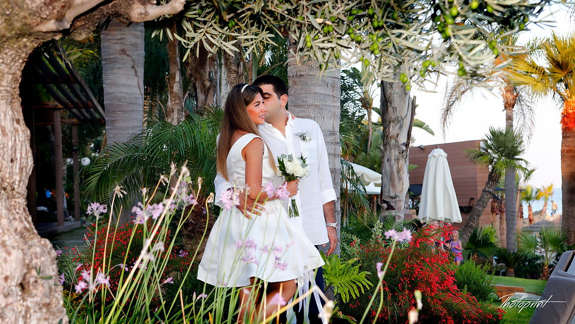 Elegant smiling bride and groom walking on the garden before the wedding at Amathus Beach Hotel in Limassol | wedding venues photographer in limassol cyprus, wedding limassol photographers cyprus