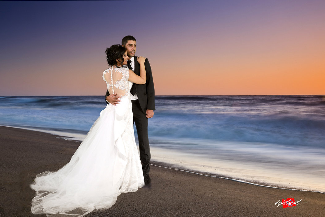 Beautiful and gentle wedding photo session outdoors of the elegant couple, bride in a white dress with veil holding a bouquet and groom in the classic tuxedo costume, romantic portrait  on Paphos beach at sunset | cyprus Paphos wedding photography  cost, wedding venues in paphos