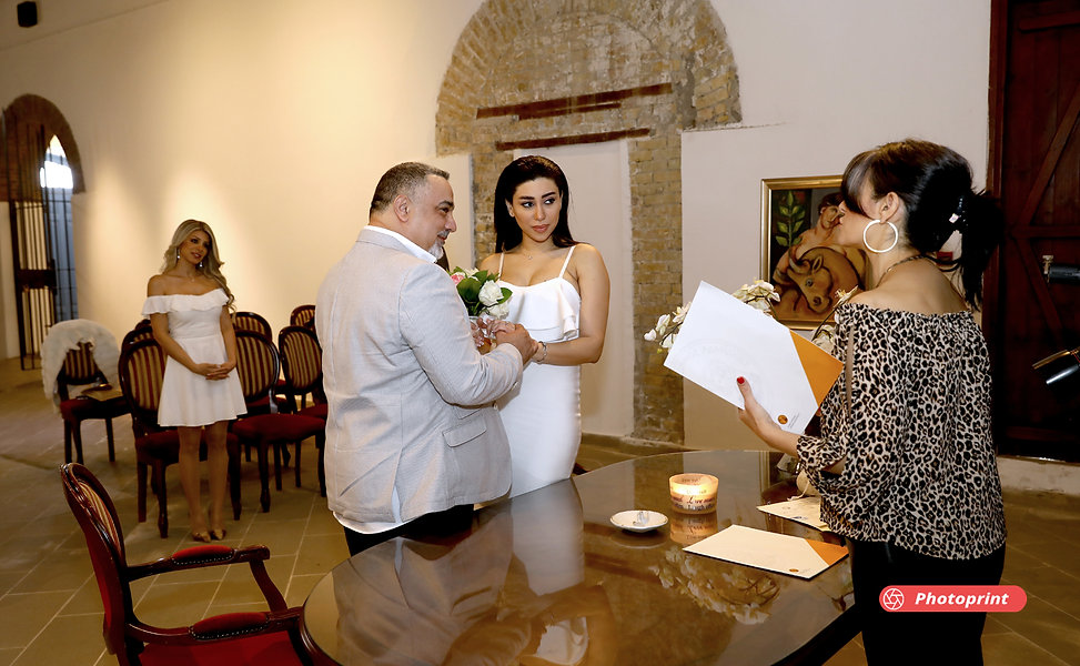 Happy couple swearing love to each other during wedding ceremony | Larnaca town hall wedding