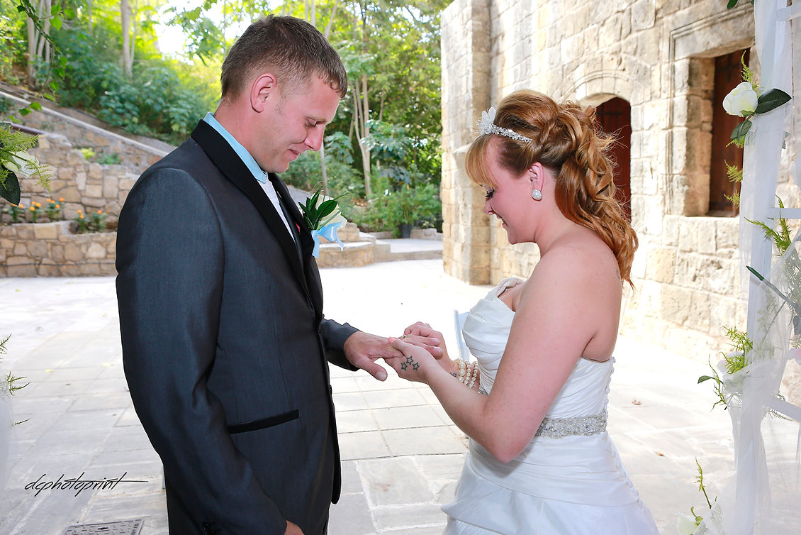 Bride putting a ring on groom's finger | cyprus cheap wedding photographers, wedding photographer in cyprus