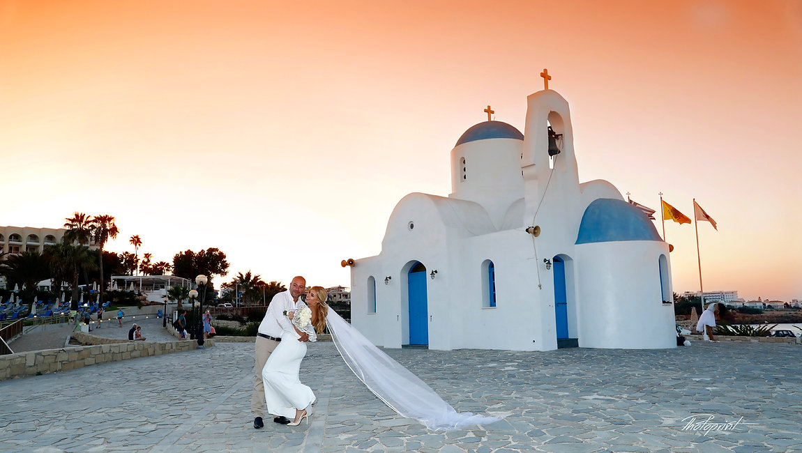 Beautiful wedding couple walking on beach at sunset holding hands near Ayios Nicolaos Church in Protaras | cyprus protaras sunset images wedding photography, best cyprus wedding photographers protaras