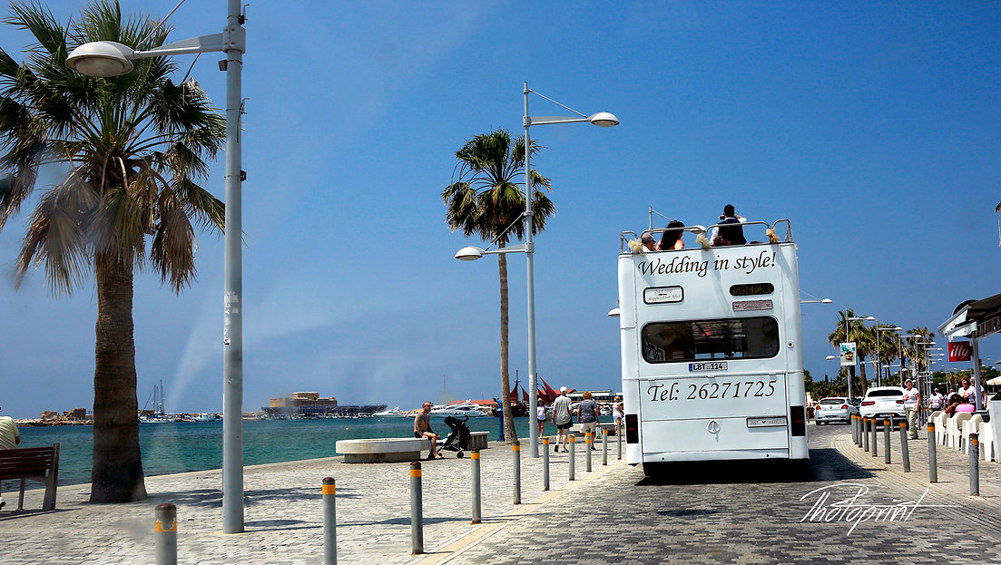 the Executive Bridal Bus travel through the paphos, the historic castle to the left of the photo | city town hall marriage at Geroskipou, wedding venues in Geroskipou, Geroskipou best wedding photos cyprus