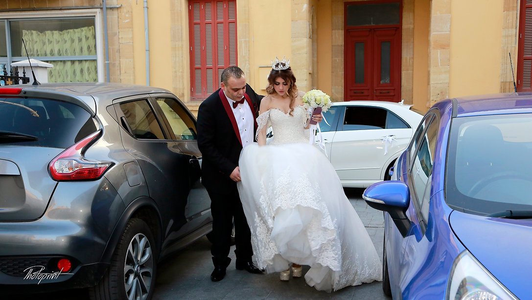 Bride and groom near a white wedding car |  photographers in nicosia cyprus, photographer in nicosia, photographer in Nicosia cyprus, wedding photographer in nicosia cyprus, wedding photographer in nicosia cyprus