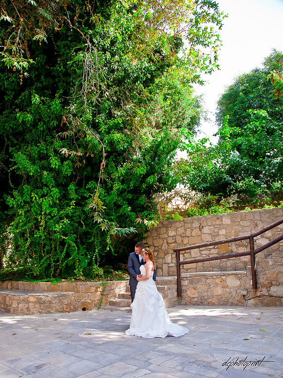before the wedding Bride and Groom kissing in the garden of Ottoman baths in Paphos, cyprus  | wedding photography paphos cyprus