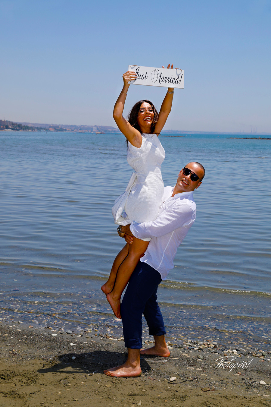 Beautiful and gentle wedding photo session outdoors of the elegant couple, bride in a white dress