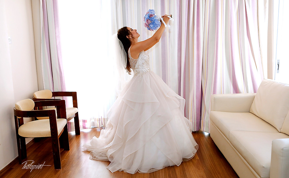Gorgeous bride in wedding dress with bouquet of flowers posing before the wedding |  wedding photography prices larnaca cyprus, wedding photography prices cyprus