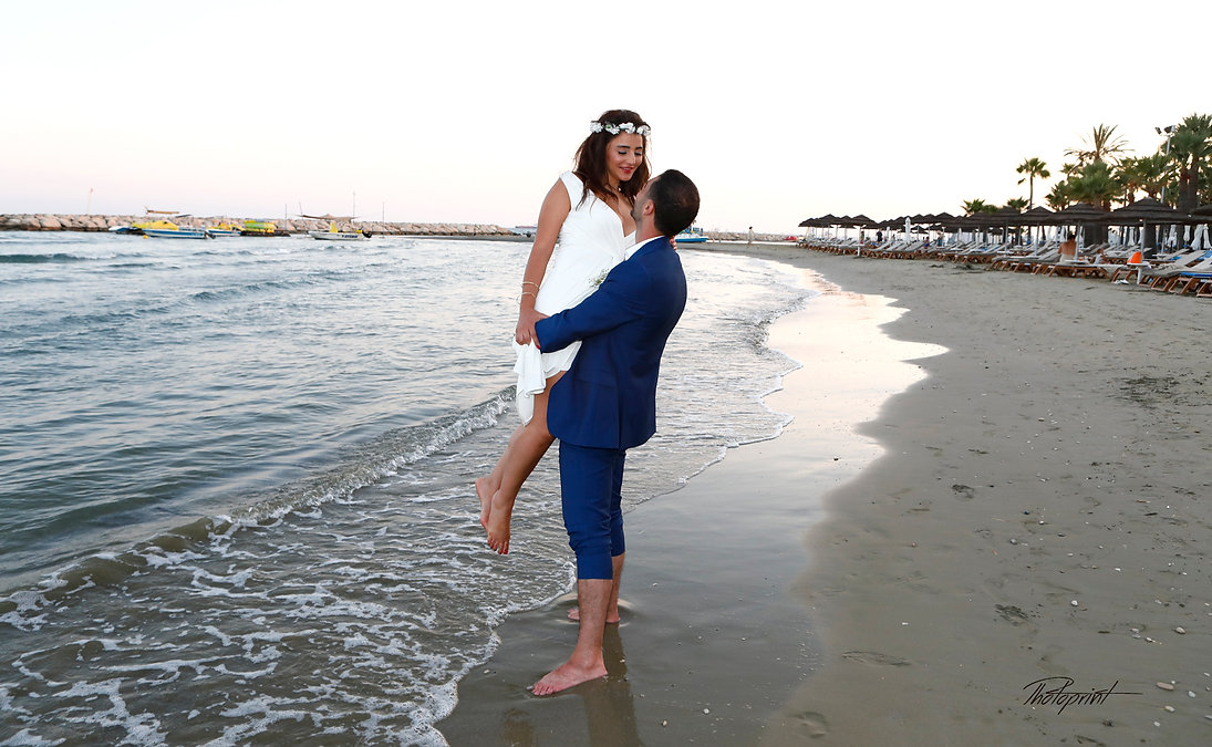 Couple in love piggyback playing in a beach at blue Mediterranean | wedding photography ideas larnaca cyprus, Larnaca best wedding photos cyprus