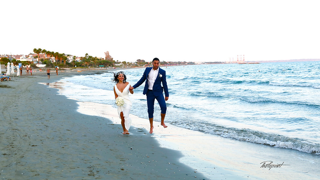 Picture of romantic young couple having a walking on the sea shore  | wedding larnaca photographer photography, cyprus wedding photographers town hall larnaca