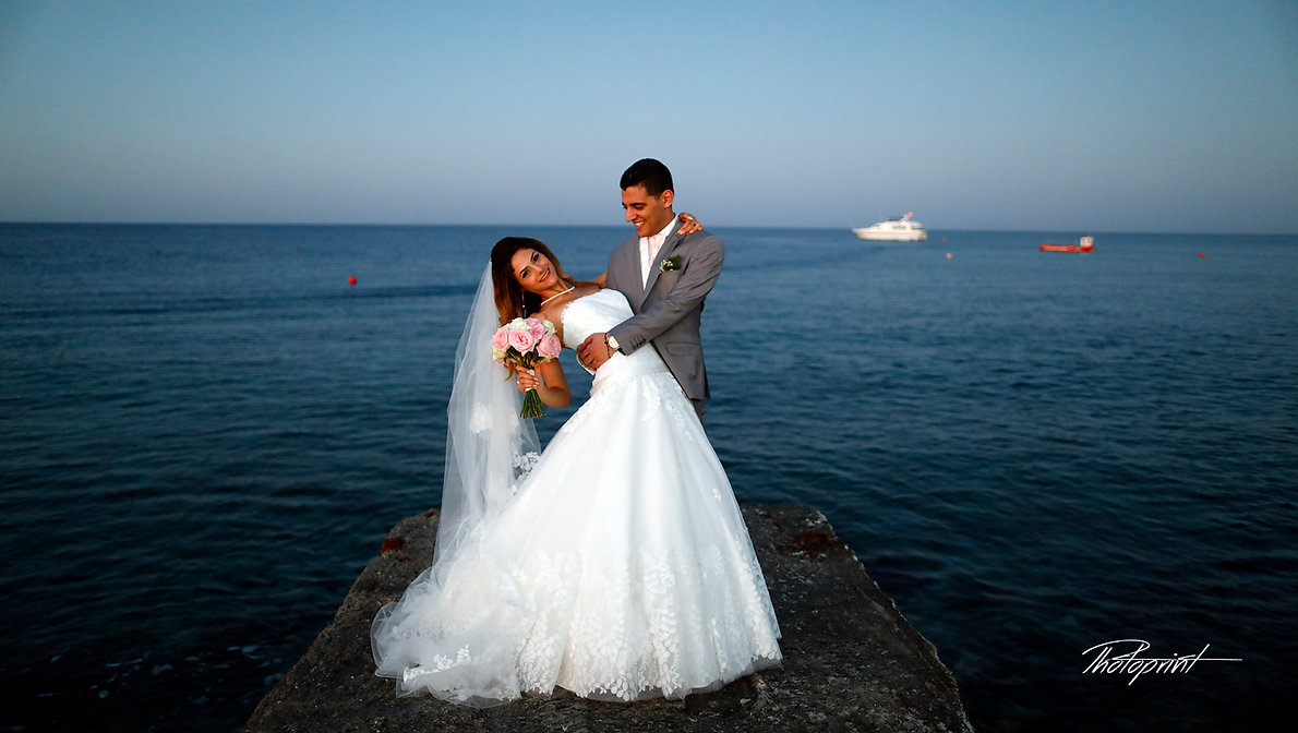 Happy just married young wedding couple celebrating and have fun at beautiful beach sunset   wedding photo cyprus, larnaca wedding photographer cost , wedding photographer cyprus