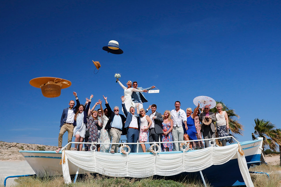 wedding celebration outdoors in boat,  guests with the newlyweds after wedding at Ammos tou Kambouri at ayia napa