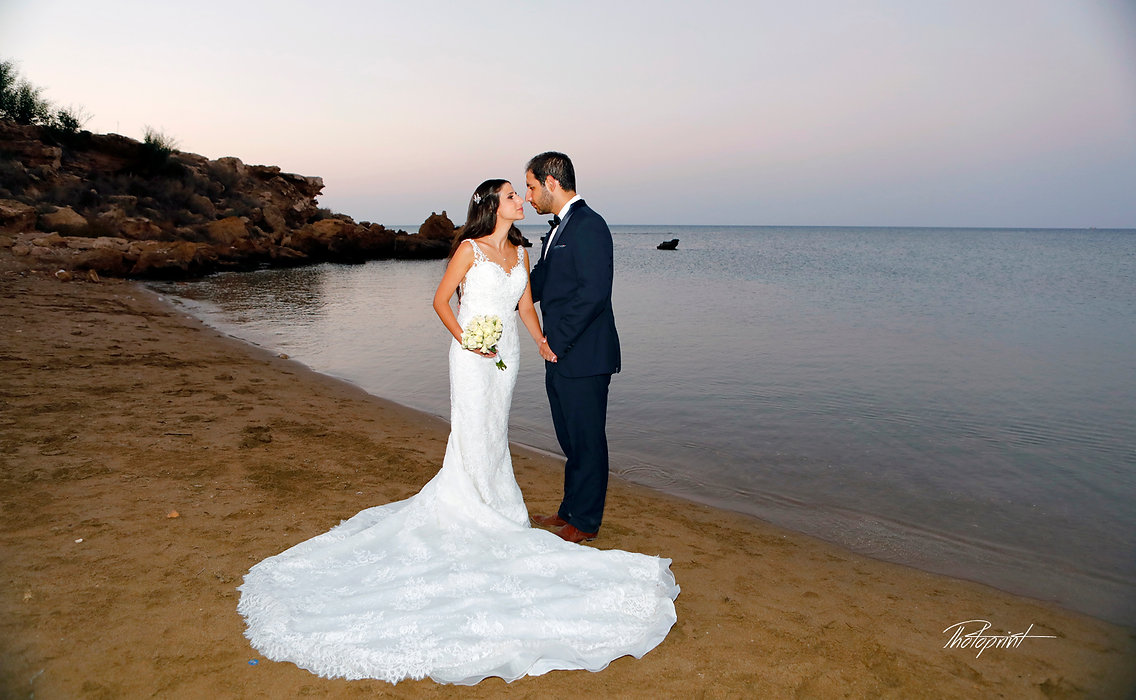 Romantic scene of kissing marriage after the wedding ceremony | cyprus wedding photography protaras,wedding photographers in protaras