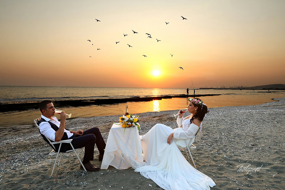 The beautiful bride with the most striking blue eyes at Sunset in a Beautiful ayia napa beach at sunset.
