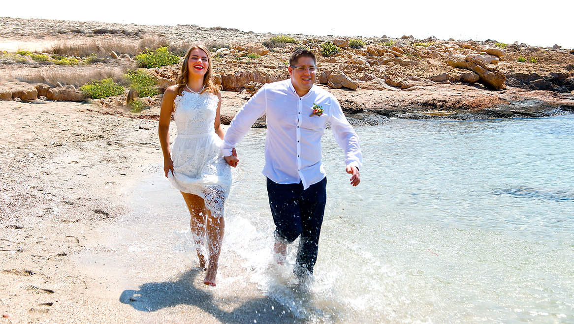 Couple running on ayia napa beach holding hands smiling | ayia napa wedding photographers, Cyprus sunset wedding images in ayia napa, unique wedding pictures cyprus,wedding photographer prices cyprus