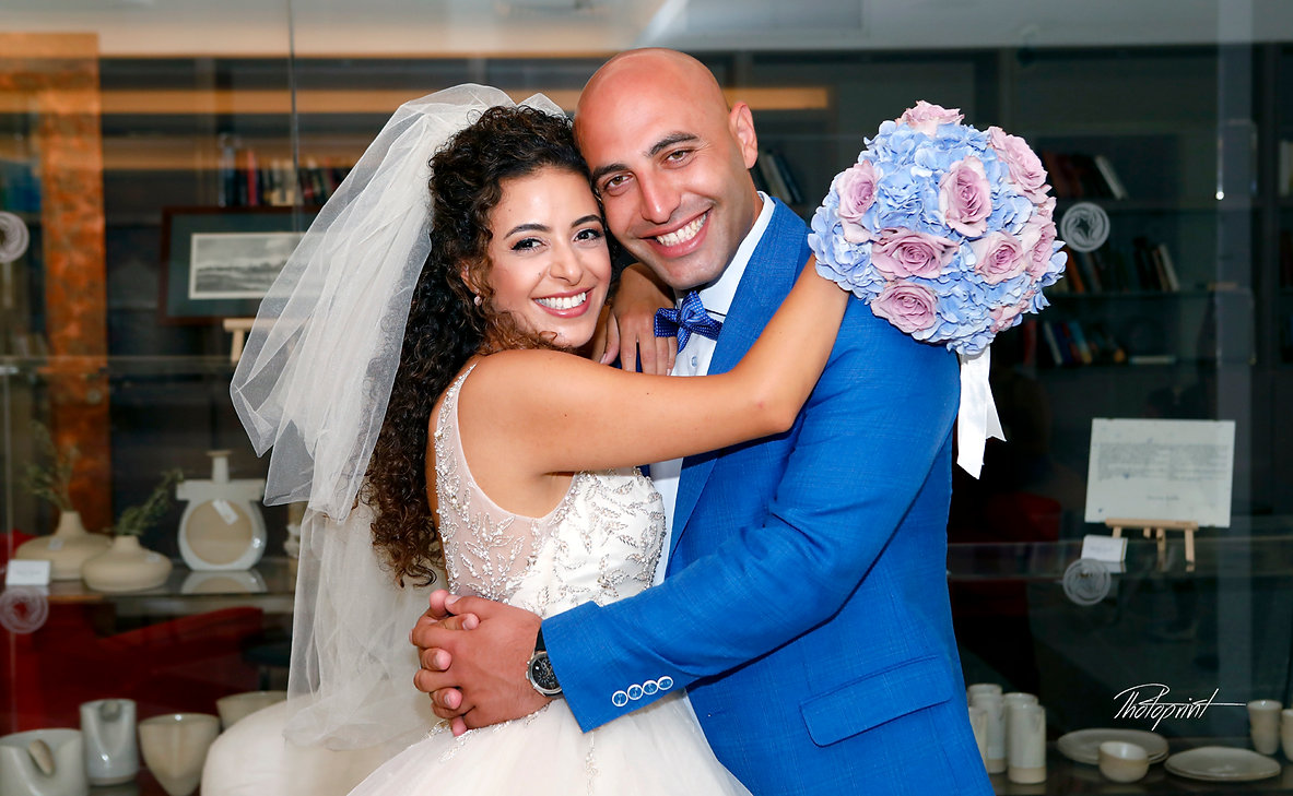 Happy just married young wedding couple celebrating in palm beach hotel larnaca, cyprus | civil marriage in larnaca cyprus, larnaca wedding photography, larnaca wedding photographers in cyprus