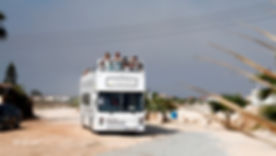 the white wedding bus brings the guests and the bride to the wedding ceremony | wedding in ayia Thekla  dream beach, civil weddings in ayia Thekla cyprus dream beach, dream beach wedding photography