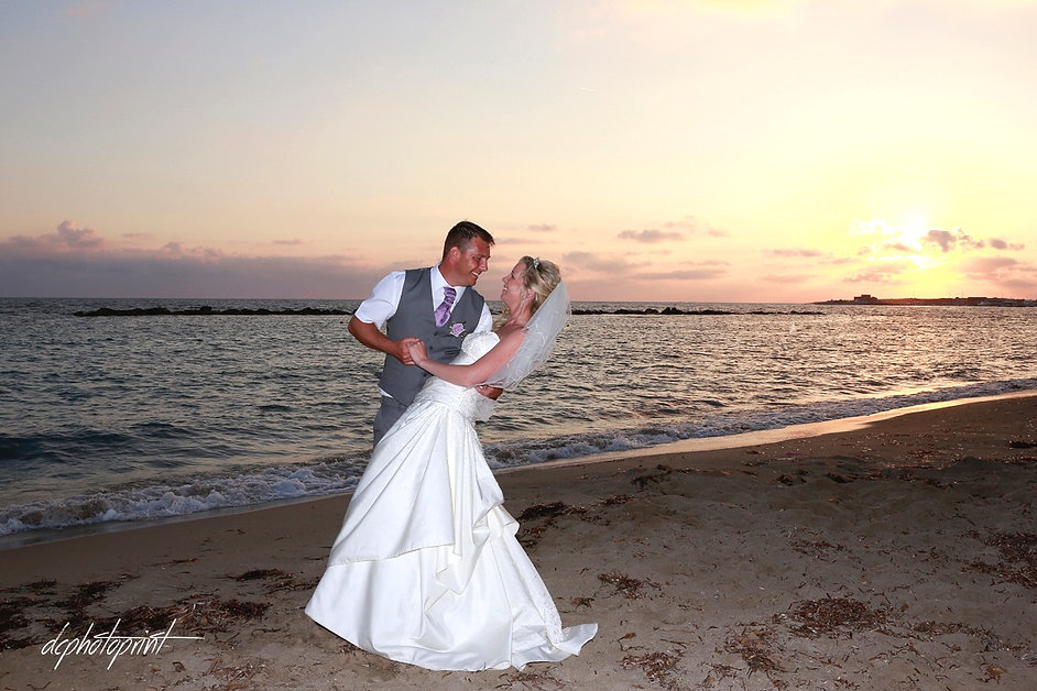 Bride and Groom, Kissing at Sunset on a Beautiful Mediterranean Paphos Beach | cyprus wedding photographers prices Paphos beach pictures,best wedding photographer in Paphos cyprus