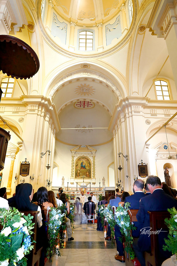Couple having their wedding ceremony inside the beautiful  church of St Mary of Graces Catholic,Larnaca