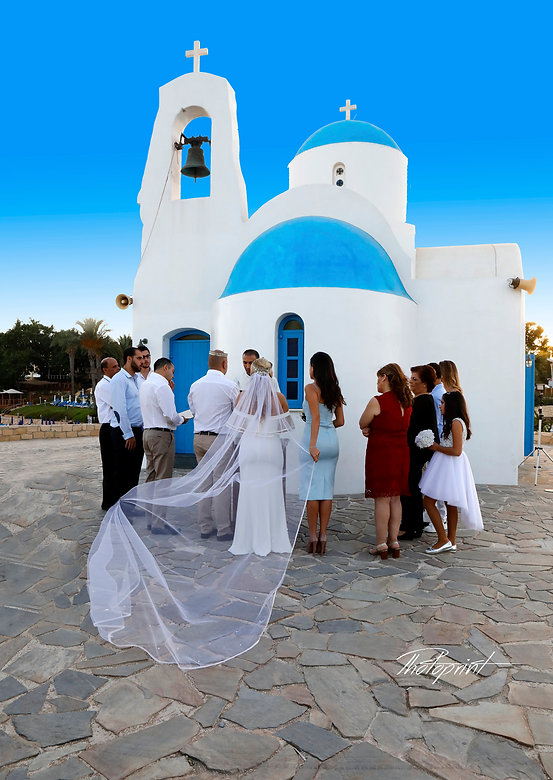 Beautiful and gentle wedding ceremony photo session outdoors at Ayios Nicolaos church in Protaras cyprus