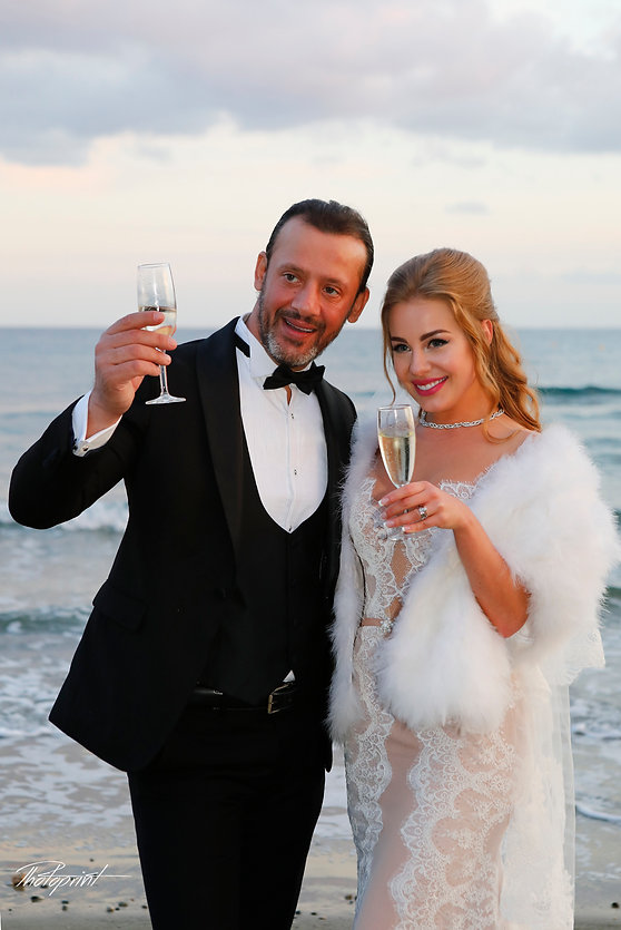 Beautiful and gentle wedding photo session outdoors of the elegant couple, Bride holding a bouquet ( Fine art photo of an attractive wedding couple )  best hotels for weddings in Larnaca,hotel weddings in larnaca cyprus, weddings in Larnaca