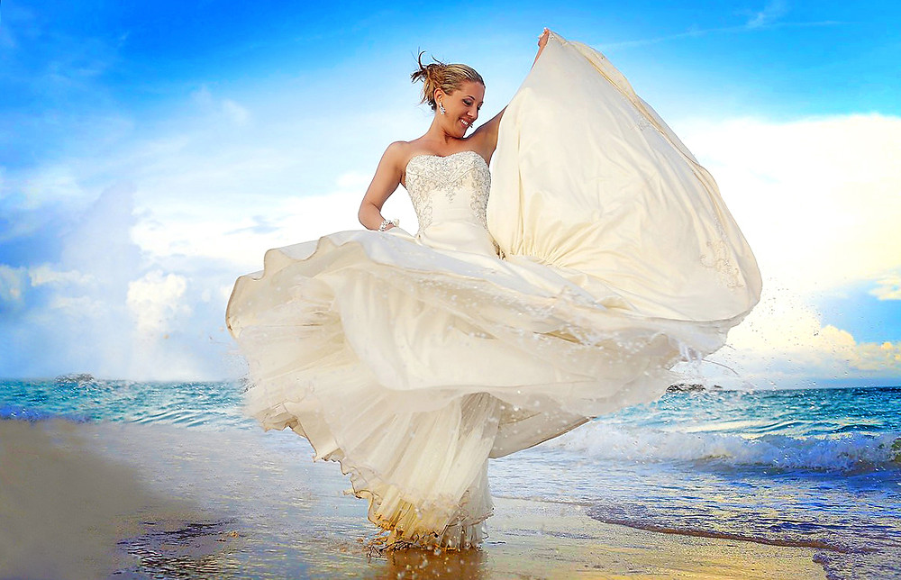 Beautiful and gentle wedding photo session outdoors of the elegant bride in a white dress
