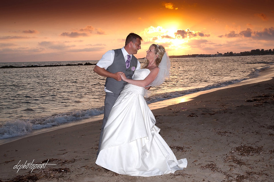 Bride and Groom, Kissing at Sunset on a Beautiful Tropical Beach of Paphos | cyprus weddings photography in town hall Paphos, best weddings photography Paphos municipality cyprus