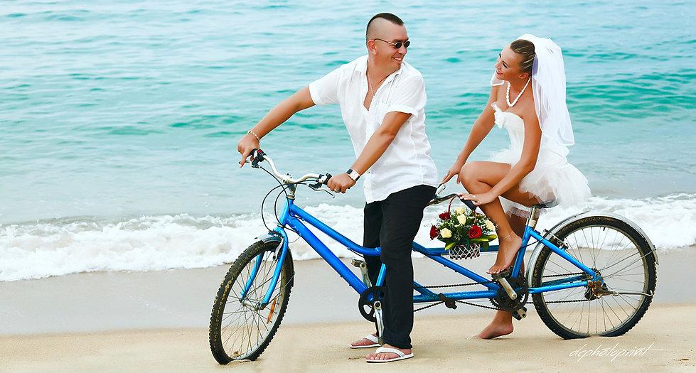 bride and groom riding a blue color bike on beach, bride wears beautiful mini wedding dress | wedding portfolio