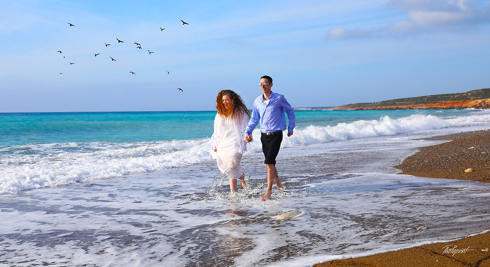 Picture of romantic young couple having a walking on the sea shore of Geroskipou Paphos